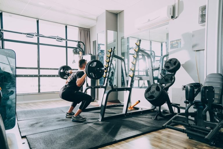 man exercising after booking home gym